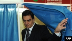 "Ali Kerimli, leader of the opposition Azerbaijani Popular Front, leaves a voting booth in Baku. Kerimli criticized the authorities, saying ""these people have completely lost the sense of responsibility, the sense of reality."""