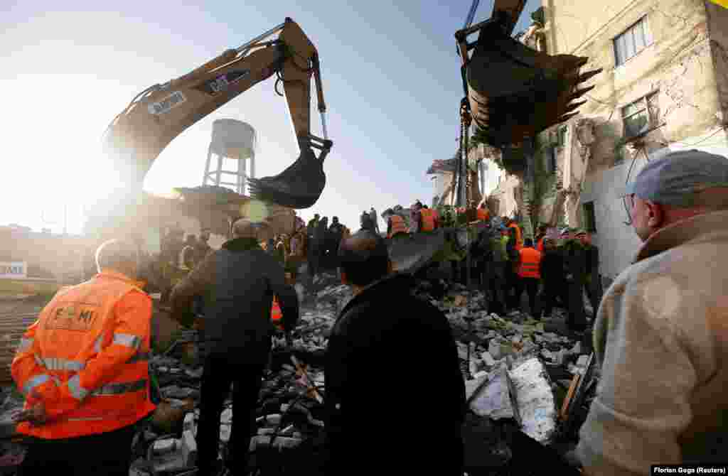 "Rescue workers searching for survivors in Thumane. Albanian Prime Minister Edi Rama​ tweeted: ""The powerful earthquake has had serious consequences and unfortunately we have lost lives... [Emergency services] are working intensively to save every possible life at some fatal points in Durres and Thumana."""