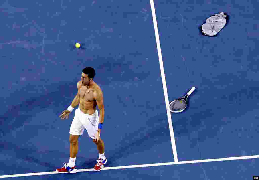 Novak Djokovic of Serbia celebrates after winning the men's singles final against Rafael Nadal of Spain at the Australian Open tennis tournament in Melbourne, Australia, on January 30. (epa/Masr Irham)