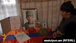 Armenia - The mother of Kyaram Sloyan, an Armenian soldier killed and decapitated by Azerbaijani troops in Nagorno-Karabakh, looks at his photogaphs, Artashavan, 10Apr2016.
