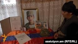 Armenia - The mother of Kyaram Sloyan, an Armenian soldier killed and decapitated by Azerbaijani troops in Nagorno-Karabakh, looks at his photogaphs, Artashavan, 10Apr2016.