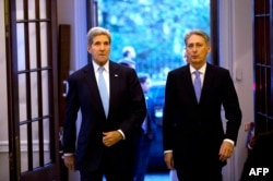 U.S. Secretary of State John Kerry (left) arrives for a meeting with Britain's Foreign Secretary Philip Hammond in London on November 18.