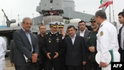 "Iranian President Mahmud Ahmadinejad (center) attended the inauguration of the ""Jamaran-2"" guided-missile destroyer in the port city of Anzali on March 17."