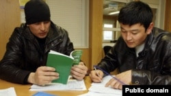 Russia -- Migrants in Russia take an exam in Russian language