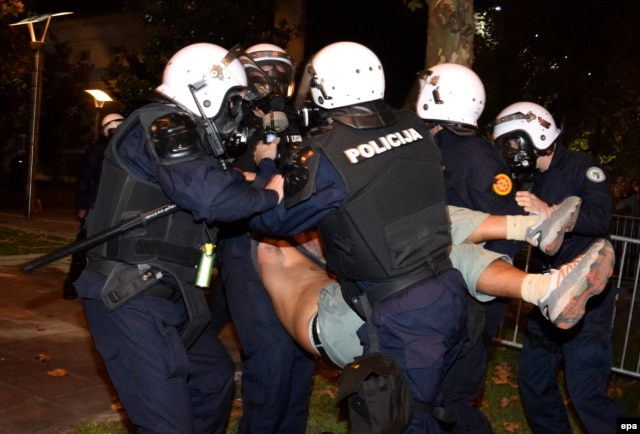 Police remove a protester from one of the demonstrations, which have occasionally been marred by violence.