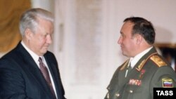 Russian President Boris Yeltsin (left) meets with Defense Minister Pavel Grachev in the Kremlin in February 1996.