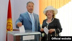 An official photo showing Kurmanbek Bakiev, who was president of Kyrgyzstan until he fled in 2010, and his wife Tatiana voting in the 2009 presidential election.