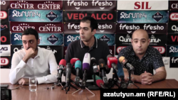 Lawyers of former Armenian President Robert Kocharian Aram Orbelian (center) and Hovhannes Khudoyan (right) at a press conference in Yerevan, August 7, 2019