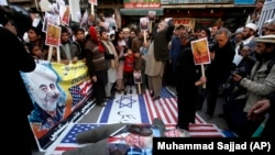 Hundreds protested in Peshawar with many chanting anti-U.S. and anti-Israeli slogans.