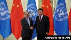 Xi Jinping (sağda) və BMT-nin Baş katibi Antonio Guterres