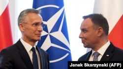 NATO Secretary-General Jens Stoltenberg (left) and Polish President Andrzej Duda speak in Warsaw on May 28.