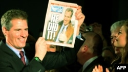 "Republican Scott Brown displays a special edition of the ""Boston Herald"" after winning the Massachusetts Senate seat."