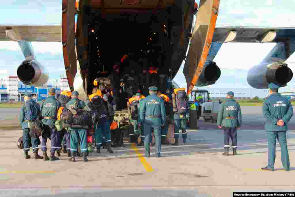 "Additional workers from Russia's Emergency Situations Ministry were flown in to help deal with the aftermath of the May spill. Greenpeace described the spill as the ""first accident of such a scale in the Arctic."""