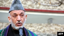 Afghan President Hamid Karzai ruled out negotiations with the Taliban until the insurgent group had an address.