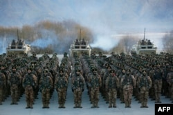 Chinese People's Liberation Army soldiers undergo military training near the Pamir Mountains in Kashgar, Xinjiang, in January.