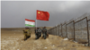 Frontier defense troops of China and Tajikistan conduct a joint patrol along the Chinese-Tajik border. (file photo)