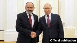 Russia - Russian President Vladimir Putin and Armenian Prime Minister Nikol Pashinian meet in the Kremlin, Moscow, October 12, 2021.