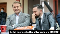 Viktor Medvedchuk (left) at his court hearing in Kyiv on October 12.