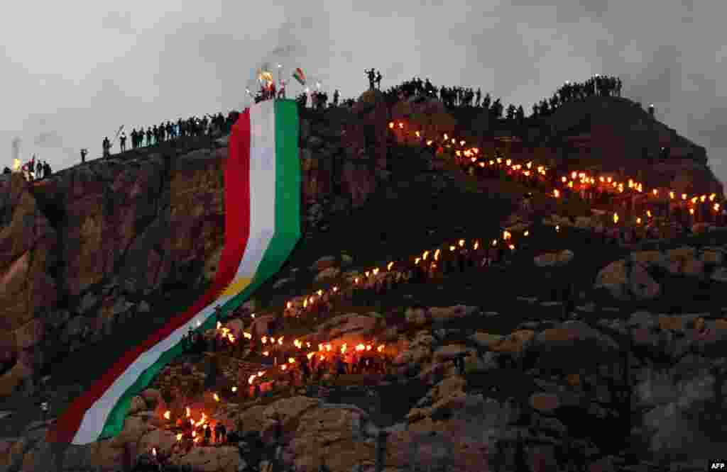 The torch-lit procession snakes up the mountainside.