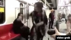 A young woman has defied Iranian law by dancing wildly on a subway train without her hijab covering her hair.