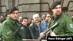 Police guard the entrance for the public of a Berlin court where one of the trials related to the Mykonos assassination took place, April 10, 1997. FILE PHOTO