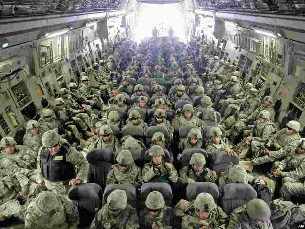 U.S. soldiers arrived from Afghanistan sit inside a plane at the U.S. airbase 30 km outside Bishkek in Manas on February 26, 2009. The soldiers who had been serving with ISAF forces in Afghanistan made a layover on their way to Germany. The United States is still holding out hope for a deal with Kyrgyzstan to avoid the closure of the U.S. military supply base there for Afghanistan even after the Kyrgyz president formalized the shutdown.