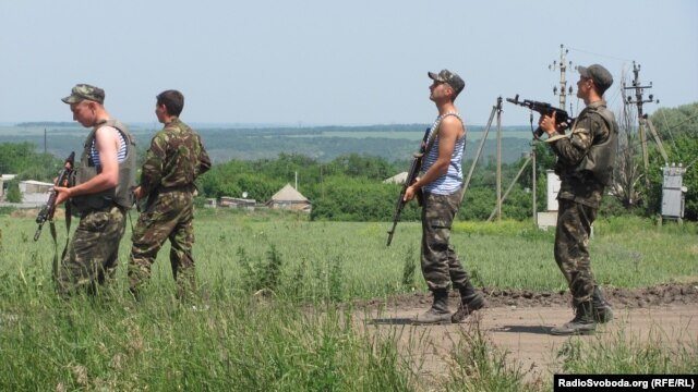 "Ukrainian military equipment and soldiers at a checkpoint in the area of ​​a ""counterterrorist operation"" on the road between Izyum and Slovyansk on June 10."