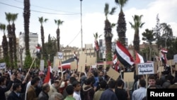 Syrian pro-reform protesters in the town of Douma