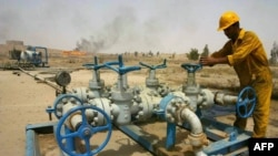 A worker checks the valves at the Kirkuk oil field.