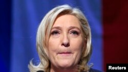 France - Marine Le Pen, French National Front (FN) political party leader and candidate for the National Front in the Nord-Pas-de-Calais-Picardie region, reacts after results in the second-round the regional elections are announced in Henin-Beaumont, Fran