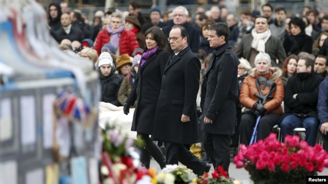 President Francois Hollande and Paris Mayor Anne Hidalgo unveiled a plaque in memory of the victims at the base of an oak tree planted at the Place de la Republique in Paris, a square that has become a symbol of French solidarity since the attacks.