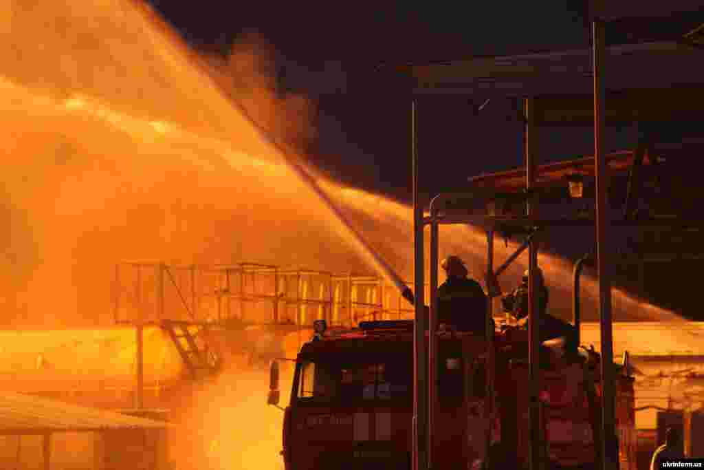 Firefighters try to split the fire overnight on June 8-9.