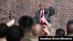 U.S. President Donald Trump delivers remarks to U.S. troops in an unannounced visit to Al Asad Air Base, Iraq December 26, 2018
