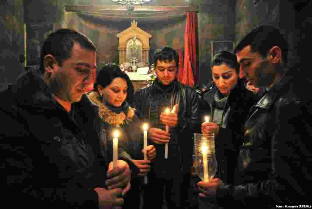 A Christmas candle liturgy inside the Khor Virap Apostolic church in Armenia.