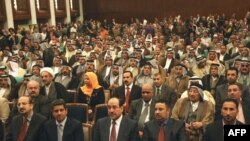 Politicians of the State of Law Coalition assemble in Baghdad.