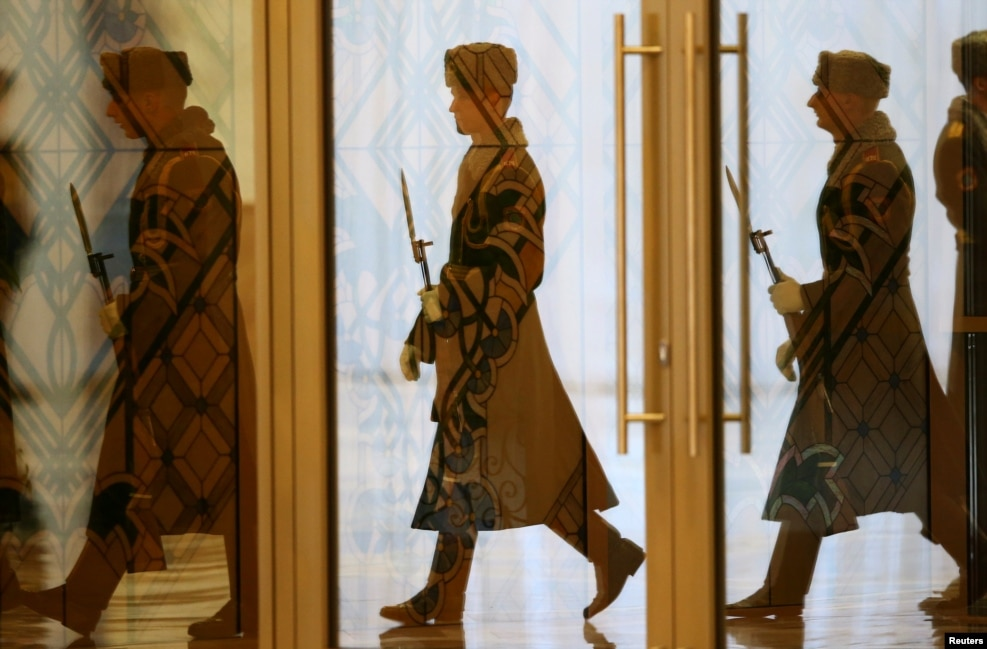 Members of an honor guard arrive at the Palace of Independence before a meeting of Belarusian President Aleksandr Lukashenka and Turkish President Recep Tayyip Erdogan in Minsk. (Reuters/Vasily Fedosenko)