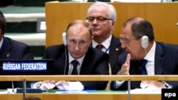U.S. -- Russian President Vladimir Putin (L) sits with Russiann Foreign Minister Sergei Lavrov (R), during the 70th session General Debate of the United Nations General Assembly at UN headquarters in New York, September 28, 2015
