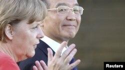 Канцлер ФРГ Ангела Меркель и премьер-министр Китая Вен Джибао.