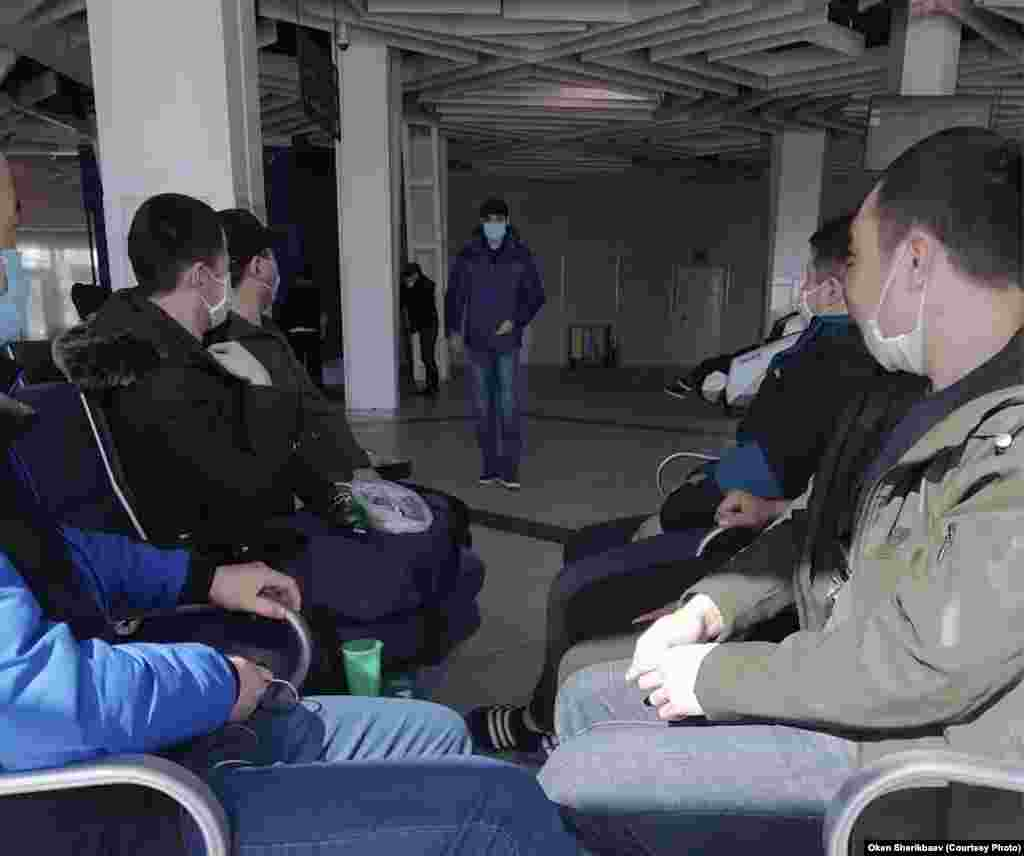 Kyrgyz migrants at Tolmachevo Airport in Novosibirsk say they lost their jobs and their apartments. They are living in limbo and are desperate for help from the Kyrgyz government.