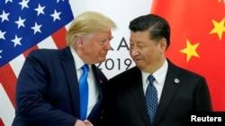 Президент США Дональд Трамп и лидер Китая Си Цзиньпин на саммите G20 в Осаке (Япония). 29 июня 2019 года.