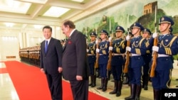 FILE: Pakistani President Mamnoon Hussain (C) attends a welcoming ceremony with Chinese President Xi Jinping (L) in Beijing (February 19, 2014).