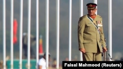 PAKISTAN -- Pakistani Army Chief of Staff Lieutenant General Qamar Javed Bajwa arrives to attend the Pakistan Day military parade in Islamabad, March 23, 201