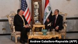 U.S. Secretary of State Mike Pompeo (left) is hosting diplomats from dozens of countries involved in the effort to defeat Islamic State militants. He is shown here with Iraqi Foreign Minister Mohammed Ali al-Hakim during talks last month in Baghdad.