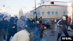 Youths attack participants in an opposition-sponsored march in Moscow.