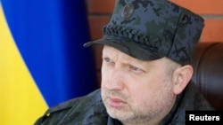 Ukraine -- Acting President Oleksandr Turchynov visits a training base of Ukraine's National Guard near Kyiv, March 31, 2014