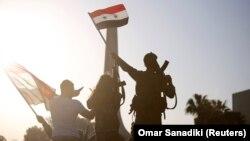 Сырыйцы ў Дамаску пратэстуюць супраць удараў кааліцыі. Фота Reuters