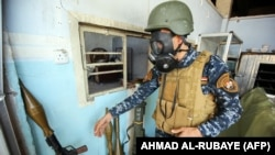 An Iraqi soldier wears a gas mask on April 16 in Mosul.