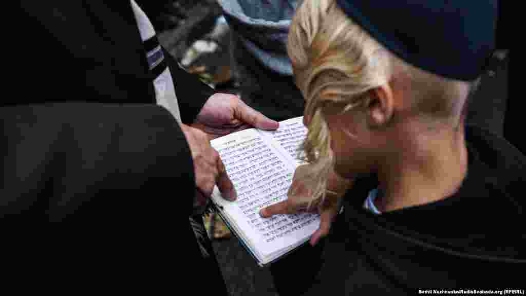 Pilgrims read Hebrew prayers during the celebrations.