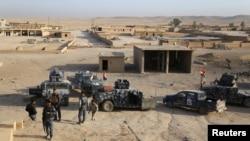 Мосулдың оңтүстік бөлігінде тұрған Ирак әскері. 18 қазан 2016 жыл.