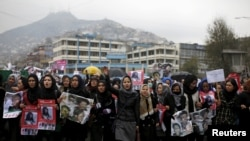 Women chat slogans during a protest against the killing of seven people from the Hazara community in Kabul on November 11.